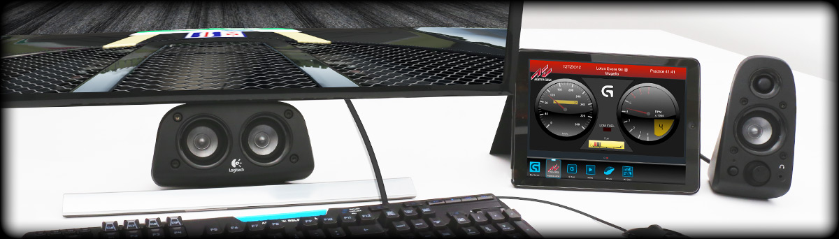 Logitech's Z906 speakers, G mouse, G910 keyboard, external monitor and tablet displaying ARX control status